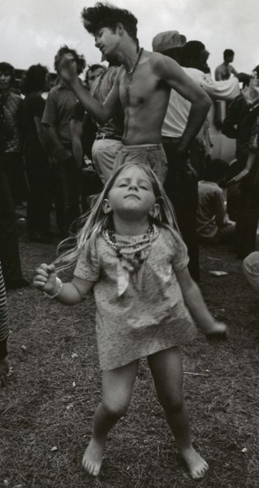 Little hippie girl rocking out.