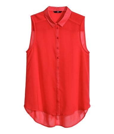 Mouwloze blouse, € 9,95.