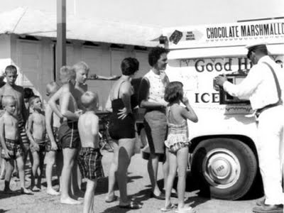 Buying ice cream treats from a man in an ice cream truck, 1970s.