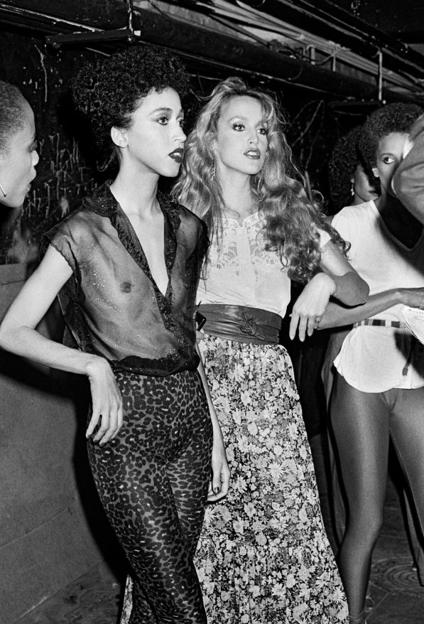 Pat Cleaveland and Jerry Hall backstage at a Studio 54 Jeans fashion show circa 1979.