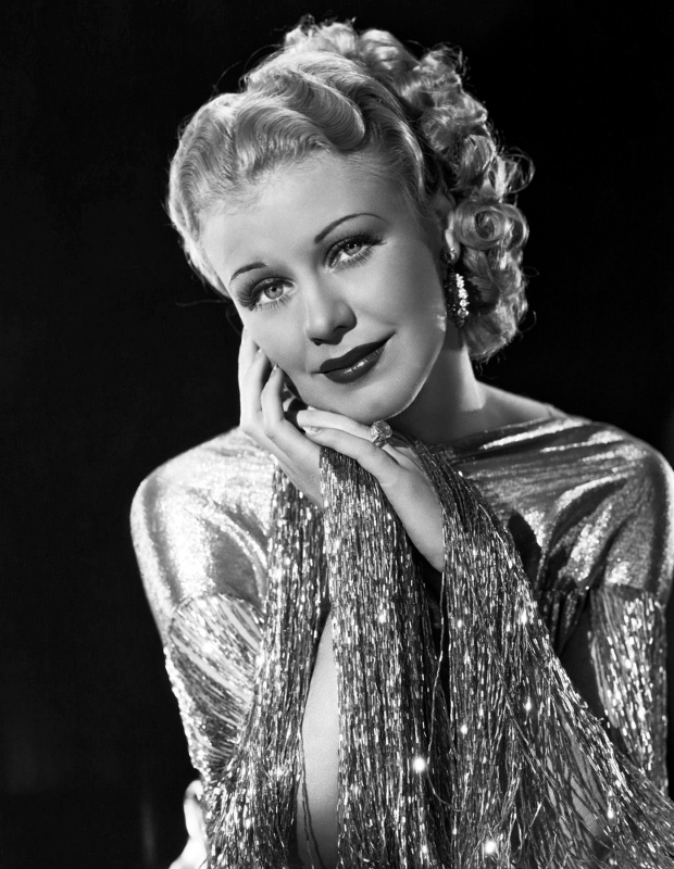 Beautiful Ginger Rogers, The Golden Girl, was never more alluring than in RKO- Radios Roberta. The glittering Metal Both of this Gown that matches her hair, makes a fitting mantle for her sparkling personality.